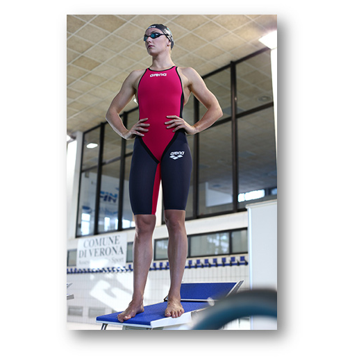 Buy Arena Red Carbon Flex Closed Back Short Leg Suit online at arenaswimwearstore.com